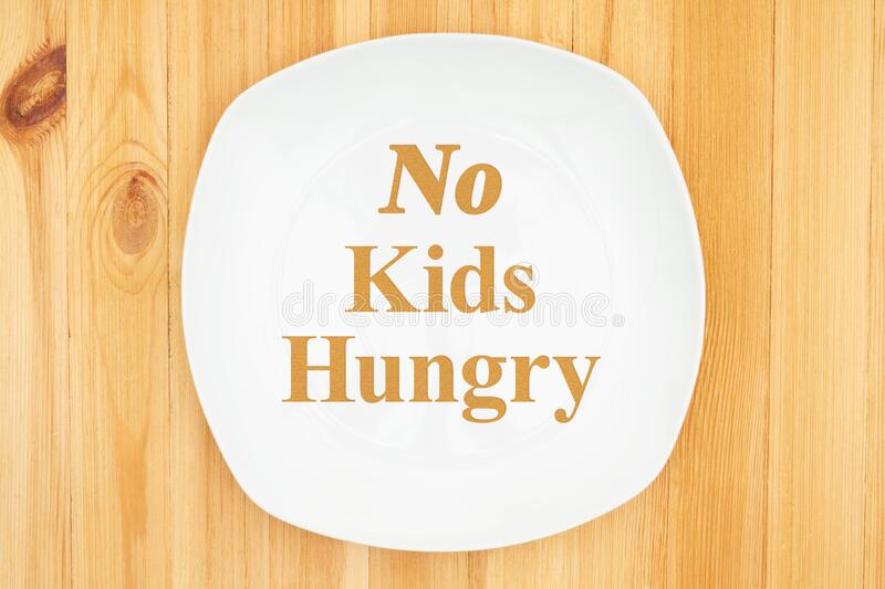 No Kids Hungry message on white empty plate stock photography