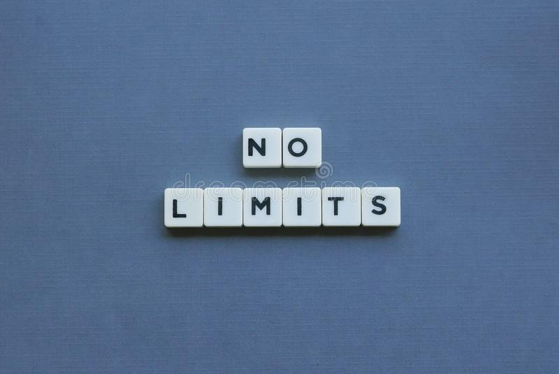 """"""" No Limits ' word made of square letter word on grey background stock images"""