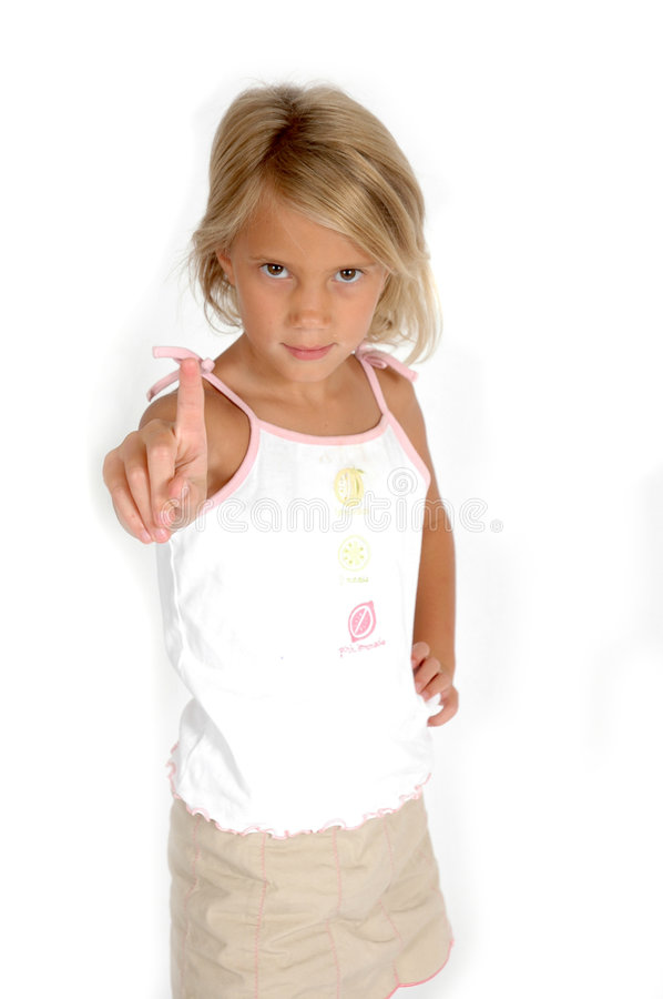 No means no. Little girl stands with her one index finger pointing in the air. Indicating the number 1, to stop, hold on or slow down. saying no stock images