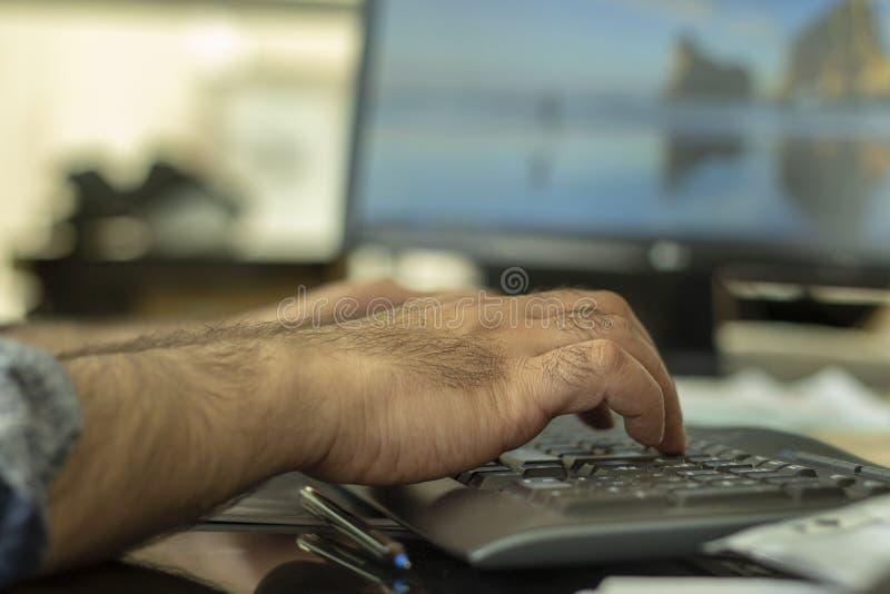 A man typing bluetooth keyboard stock photo