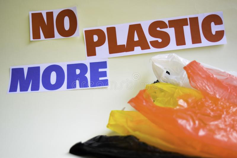 No more plastic message. It shows a plastic with motto and selective focus no more plastic text royalty free stock photography