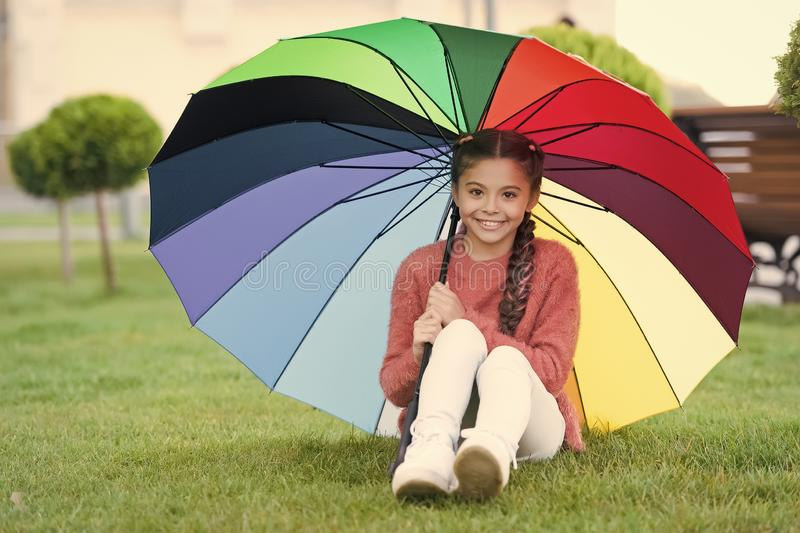 No more rain. Optimist and cheerful child. Spring rain. Positive mood in autumn rainy weather. Rainbow after rain. Little girl under colorful umbrella stock image