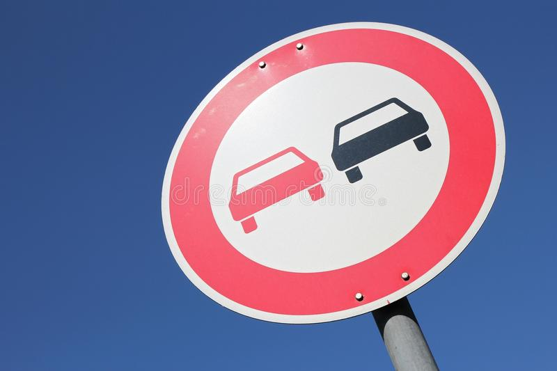 No overtaking. German road sign: no overtaking royalty free stock photos