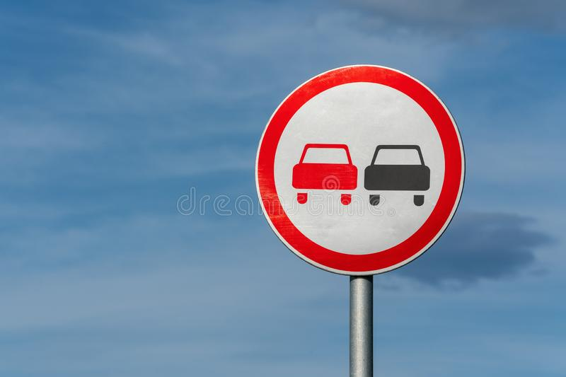 No overtaking road traffic sign with two cars. Information and warning road traffic street sign, compliance with rules. Copy space, background for education royalty free stock image