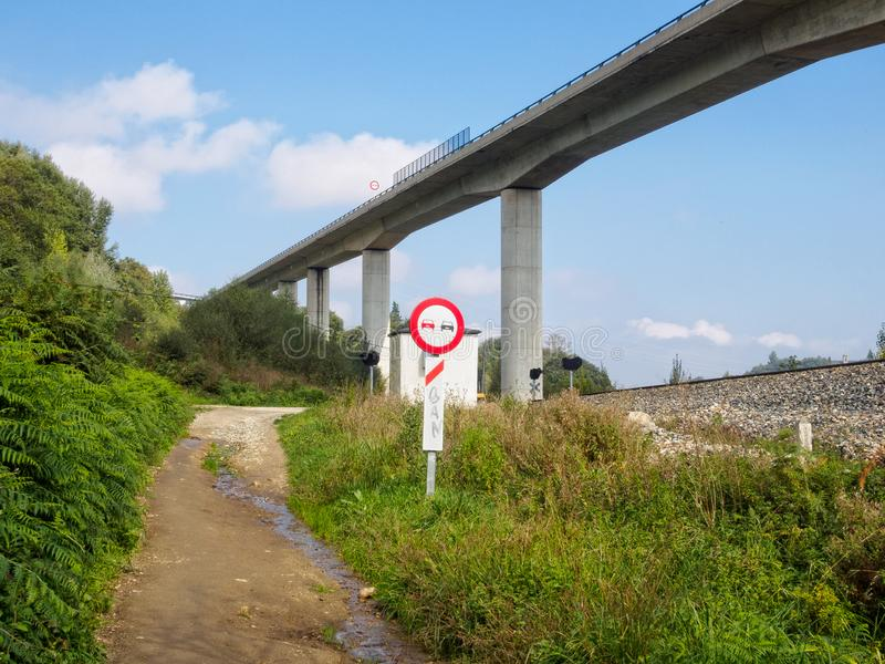 No overtaking - Sarria. `No overtaking` on this dirt road under the viaduct - Sarria, Galicia, Spain royalty free stock photography