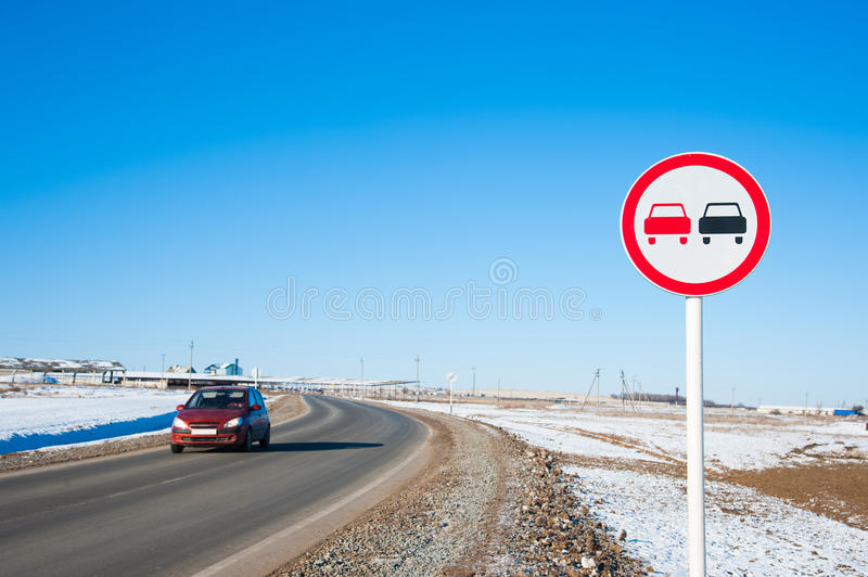 No overtaking sign. In suburban highway on sunny winter day stock image