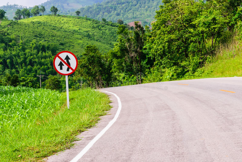 No Overtaking traffic sign board on national highway. because Steep Hill Descent and Winding Road royalty free stock photos
