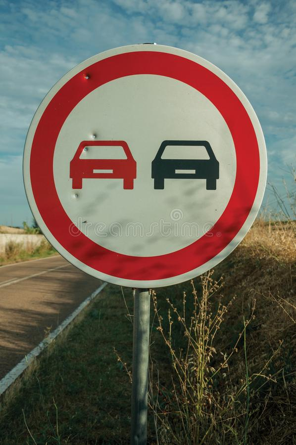 NO OVERTAKING traffic sign perforated by bullet stock images