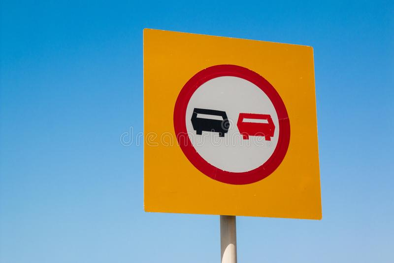 No overtaking. A traffic sign with no overtaking or prohibition of overtaking royalty free stock photography