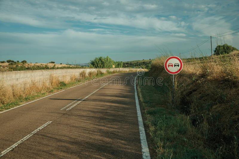 NO OVERTAKING traffic sign in a road near Elvas royalty free stock image