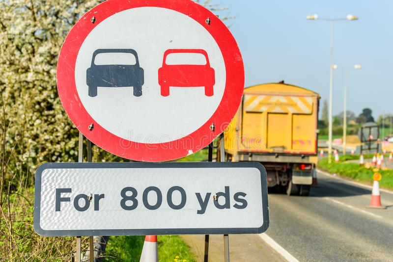 No Overtaking 800 yards Zone sign on UK motorway with lorry on background.  royalty free stock photography