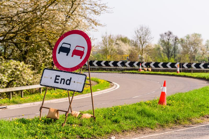 No Overtaking Zone ends sign on UK motorway.  stock images