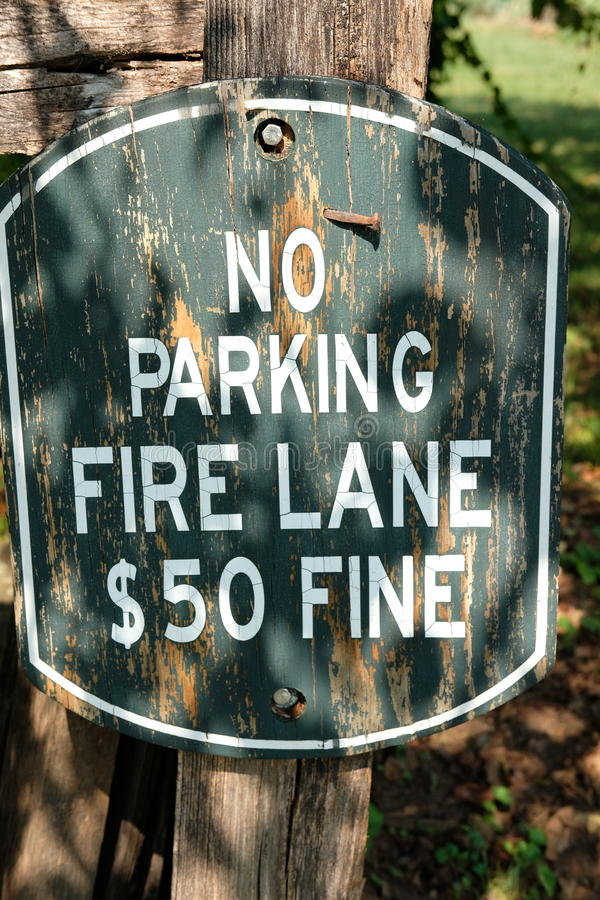 No Parking. On the fire lane with $50 fine road sign, don`t park royalty free stock photo