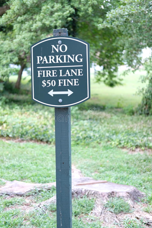 No Parking. On the fire lane with $50 fine road sign, don`t park stock photo
