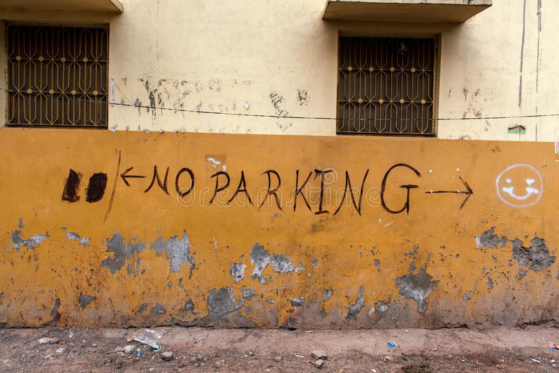 `No Parking` graffiti on yellow wall.  royalty free stock photography