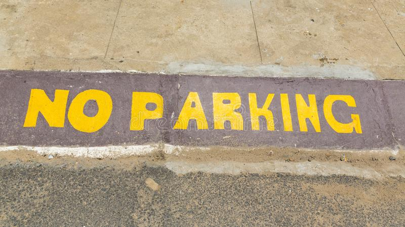 No Parking painted asphalt. No Parking painted yellow gray asphalt road stock image