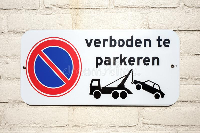 No parking sign indicating that parked cars will be towwed. royalty free stock photo
