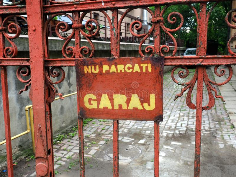 No Parking Sign on Rusted Metal Garage Gate, Romania stock image