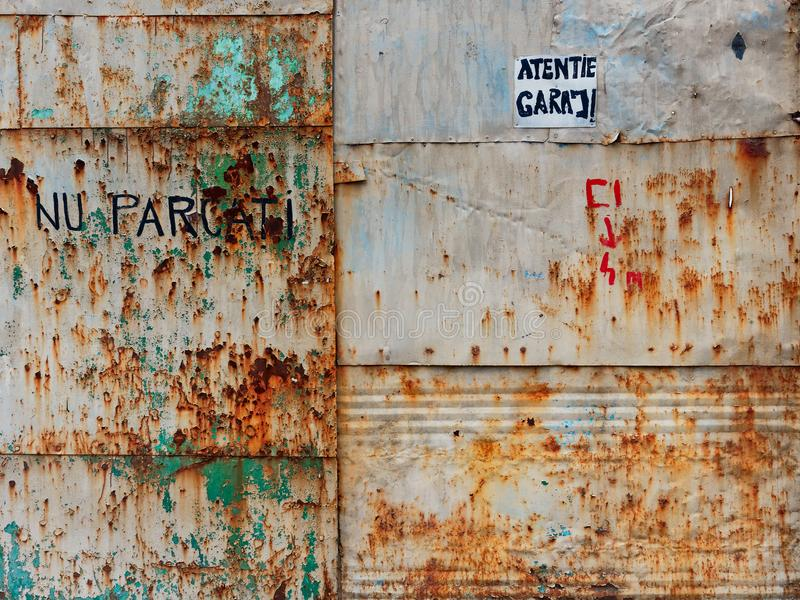 No Parking Sign on Rusted Metal Garage Gate, Romania royalty free stock image