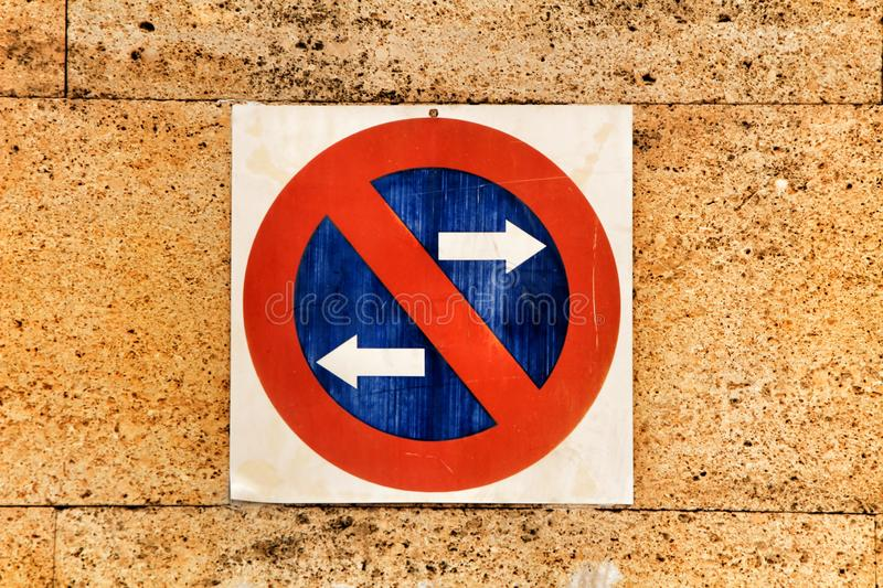 No parking sign on stone wall royalty free stock photo