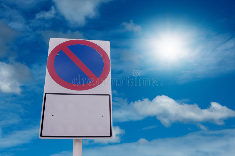 No parking traffic sign and blue sky with sun light. On holiday stock photography