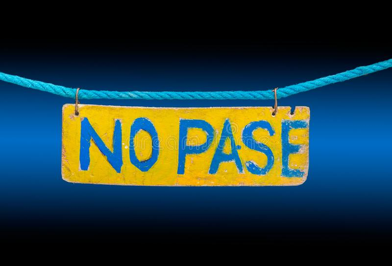 No Pase sign blue & black blackground. No Pase sign blue rope, blue and black background stock photo