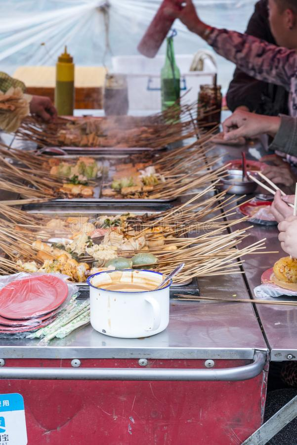 Harbin hot-pot food, sharing, chinese, bamboo skewers in soup stock photography