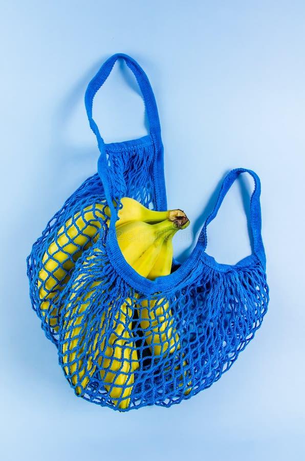 No plastic. babanas in a blue mesh bag. Concept no plastic. bananas in a blue mesh bag. free plastic, color, disposable, ecology, environment, environmental royalty free stock photography
