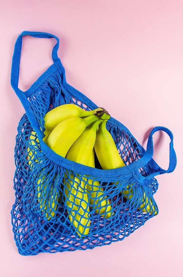 No plastic. babanas in a blue mesh bag. Concept no plastic. bananas in a blue mesh bag. free plastic, color, disposable, ecology, environment, environmental stock photos