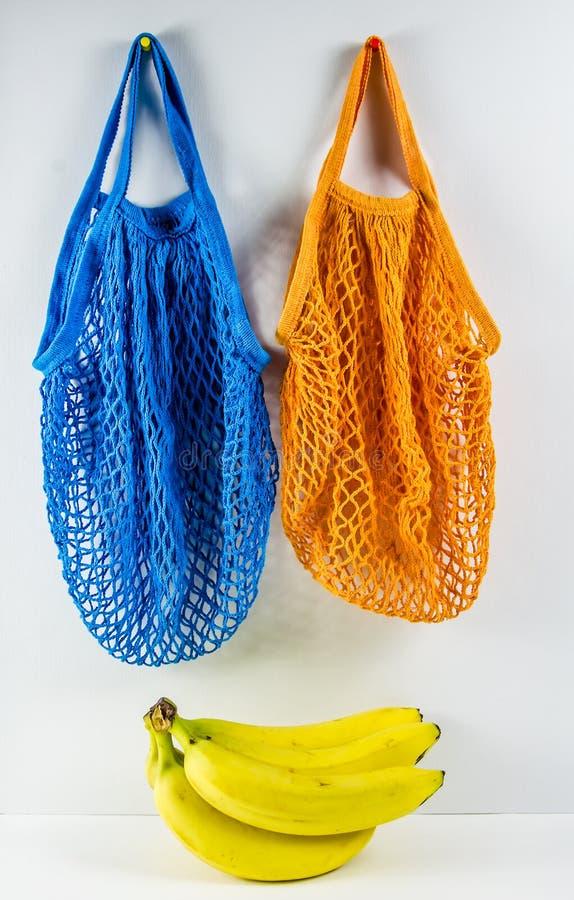 No plastic. babanas in a blue mesh bag. Concept no plastic. bananas in a blue mesh bag. free plastic, color, disposable, ecology, environment, environmental royalty free stock photo