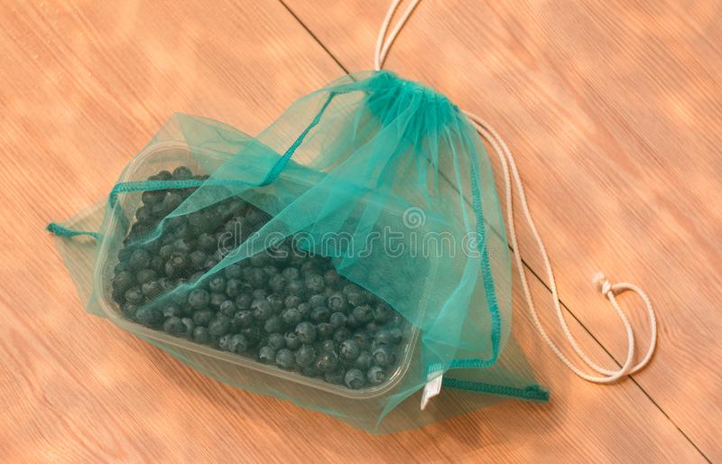 No plastic bag zero waste concept, blueberry in blue eco bag. royalty free stock photography