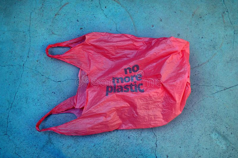 No plastic. Environmental awareness. Red plastic garbage bag with motto royalty free stock photos