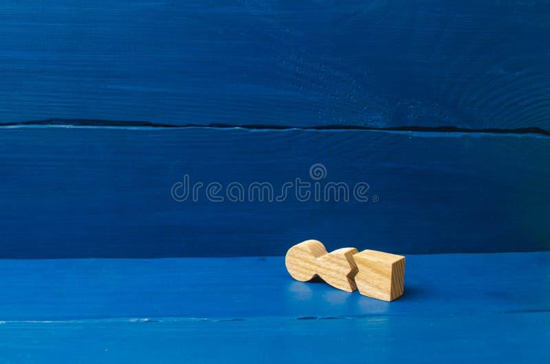 No podía colocar los nervios y nuestra salud Amenaza de la vida Lesión y muerte Nunca dé para arriba Una figura de madera de un h imagen de archivo libre de regalías