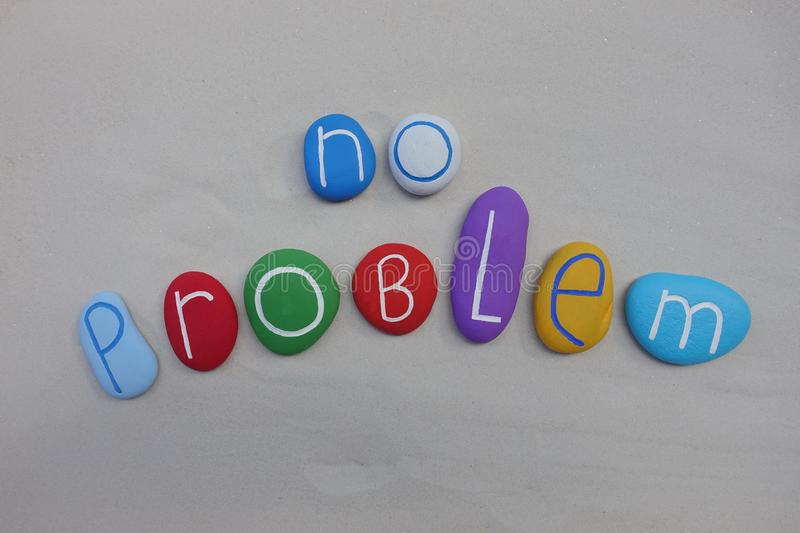 No problem, positive message composed with colored stones over white sand royalty free stock images