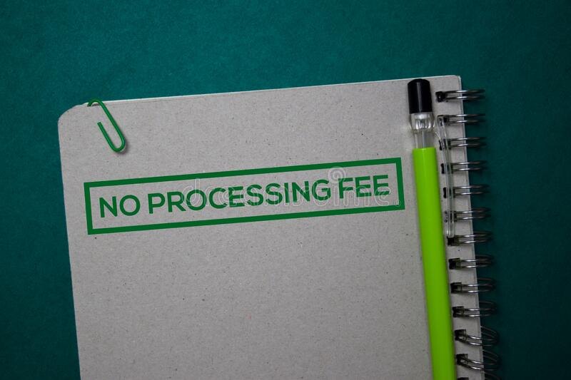 No Processing Fee write on a book isolated on green background stock images