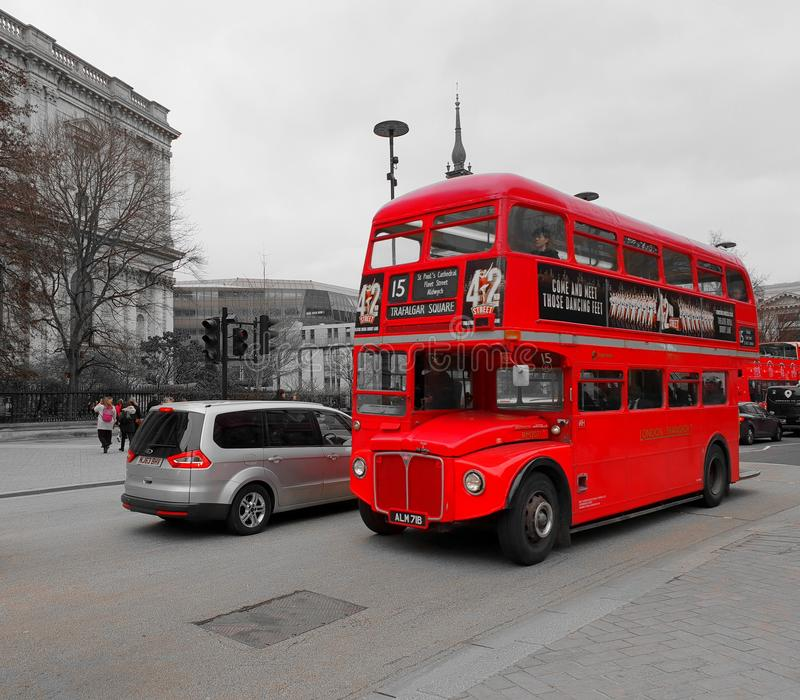 No.15 RouteMaster bus travelling through St Paul`s Cathedral during a cloudy afternoon. LONDON, ENGLAND, MARCH 22ND 2018: No.15 RouteMaster bus travelling stock image