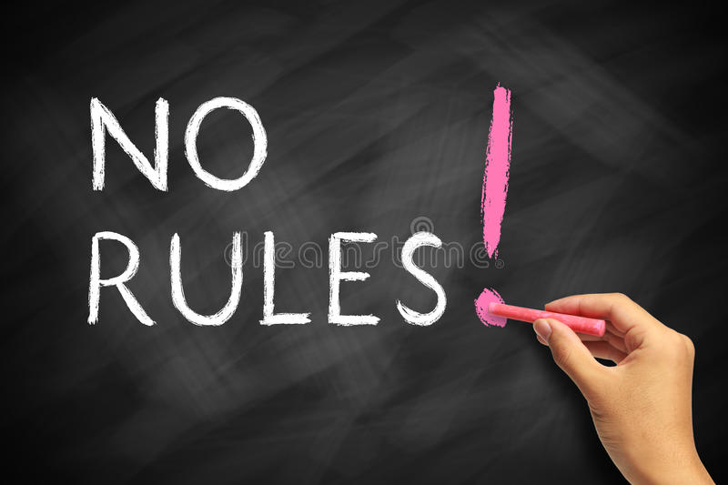 No Rules. Hand with red chalk writing No Rules Concept on chalkboard stock photos