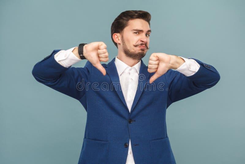 No , it`s bad news! Man showing dislike stock photo