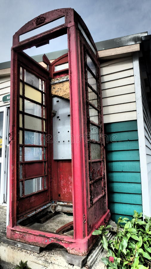 No Servise in the Apocalypse. A rusty old broken red phone box in england. Looks very deserted royalty free stock images