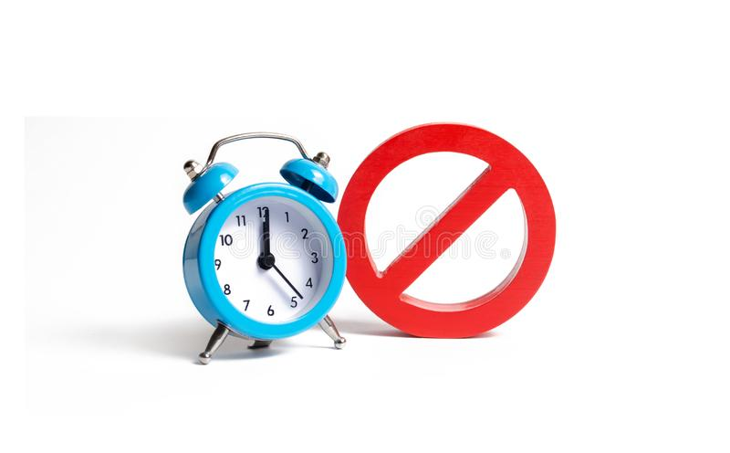 No sign and blue clock on an isolated background. Unavailability at certain hours. Temporary restrictions and prohibitions. Restrictions and sanctions, strict royalty free stock image