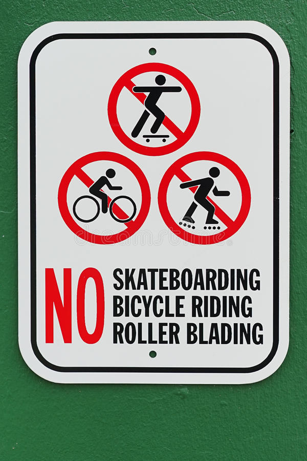 No skateboarding bicycle riding roller blading sign with green background. No skateboarding bicycle riding roller blading sign. A set of three signs for various stock images