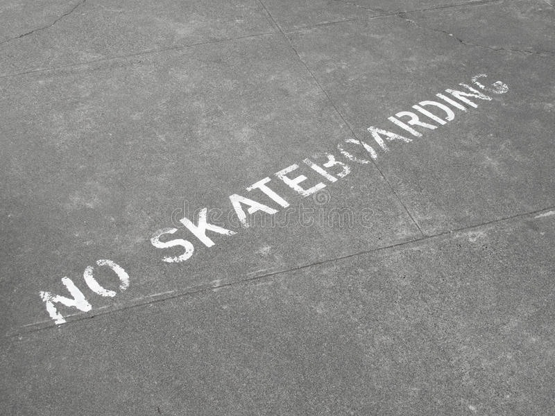 Download No Skateboarding Sign Painted On Sidewalk Stock Photo - Image: 10476026