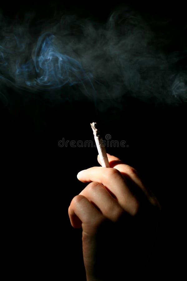 No smoke. Hand smoke on black background stock photos