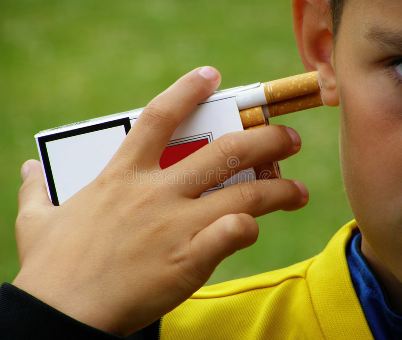 No smoking. Close-up of a person showing the danger of start smoking at an early age