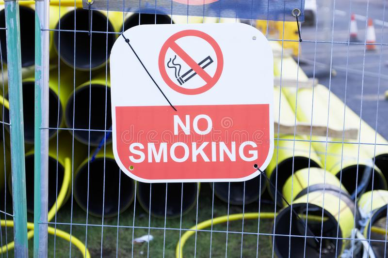 No smoking construction safety sign and yellow gas pipe for external works explosion risk stock image