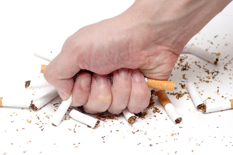 No Smoking!. Man trying to give up smoking. Conceptual image royalty free stock photos