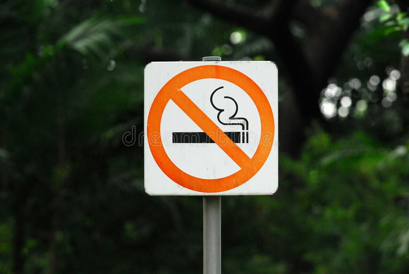 No Smoking Sign is in a Public Park royalty free stock photos