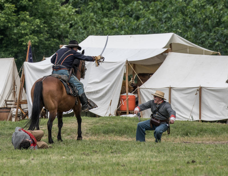 No Surrender. Civil War era soldiers in battle at the Dog Island reenactment in Red Bluff, California stock photography