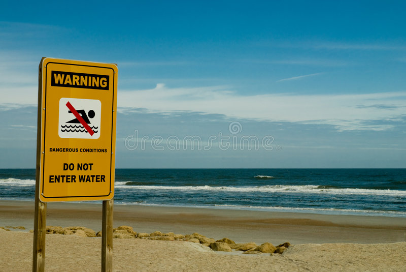 No Swimming. Sign warning of unsafe ocean (water) conditions. Closed Beach stock photography