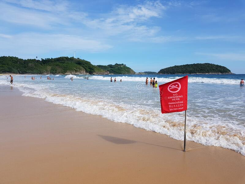 No swimming sign flaf for security information on the beach royalty free stock photography